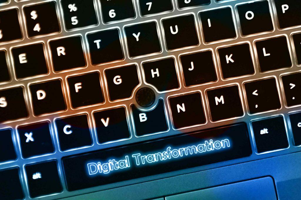 laptop keyboard with a digital transformation text on spacebar