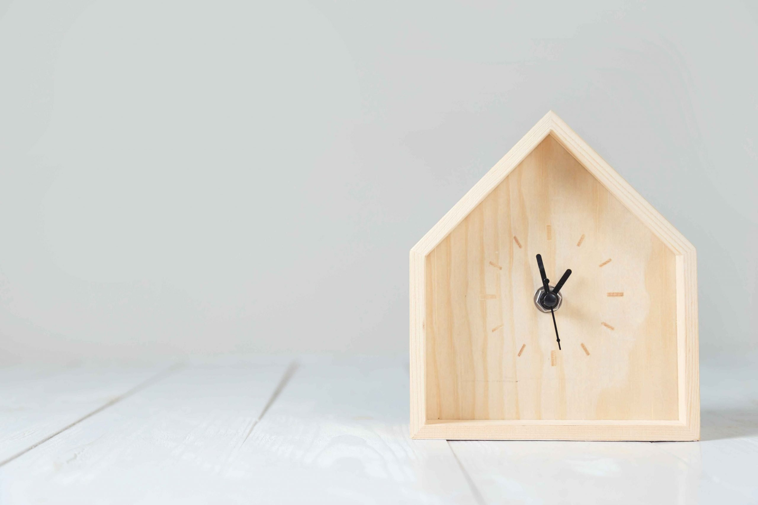 wooden table clock in the shape of a house
