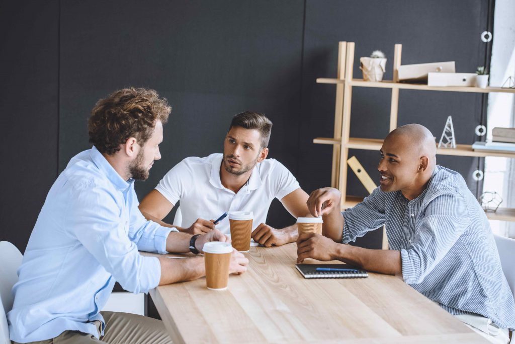 three man discussing about their business succession plan