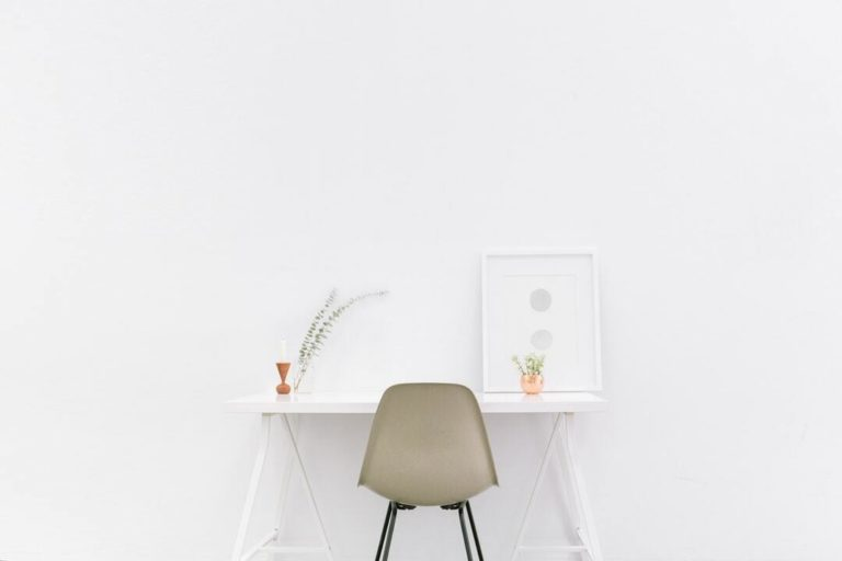 chair in a white table and white wall