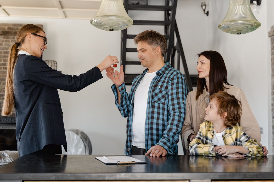 Man receiving the key on their newly acquired property